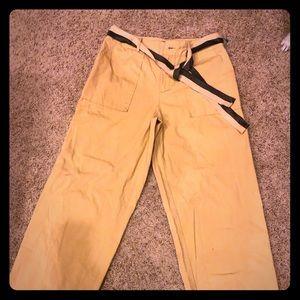 Khaki wide leg pants with fabric belt.
